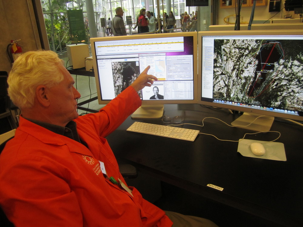 """Academy docent, Ted Olsson""""georeferenced"""" historic locations written on Valley Oak herbarium sheets.The data were incorporatedintomodels projecting the impact of climate change on Valley Oak species in the future."""