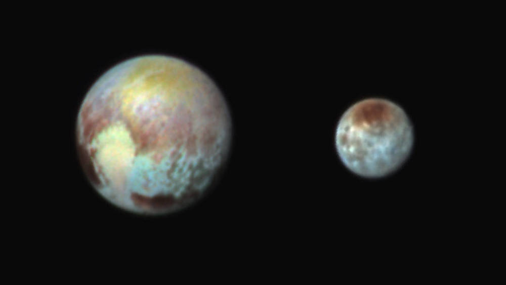 False-color image of Pluto and Charon. Scientists use false-color imagery to make certain features stand out better. Photo: NASA