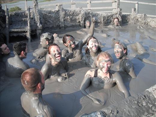 People bathing in a mud volcano.