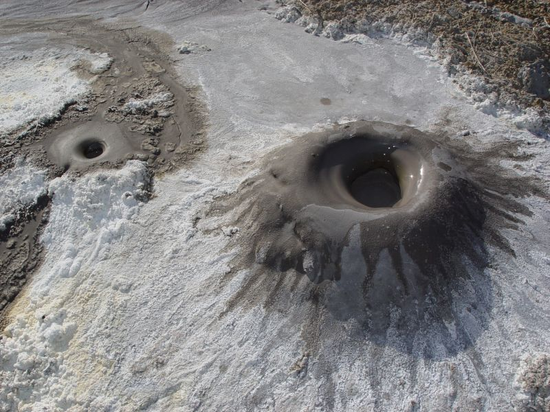 A smaller mud volcano, known as a mud pot