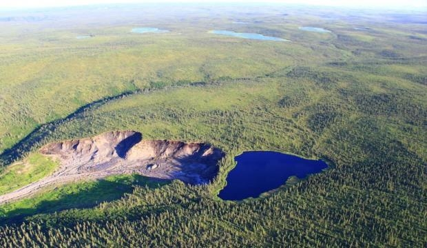 The unnamed lake in Northwest Territories, Canada that is literally expectedto fall off a cliff later this year. Increased temperatures and rainfall have melted away permafrost that stabilizes the lake. Photo:Scott Zolkos, University of Alberta and Vice.com
