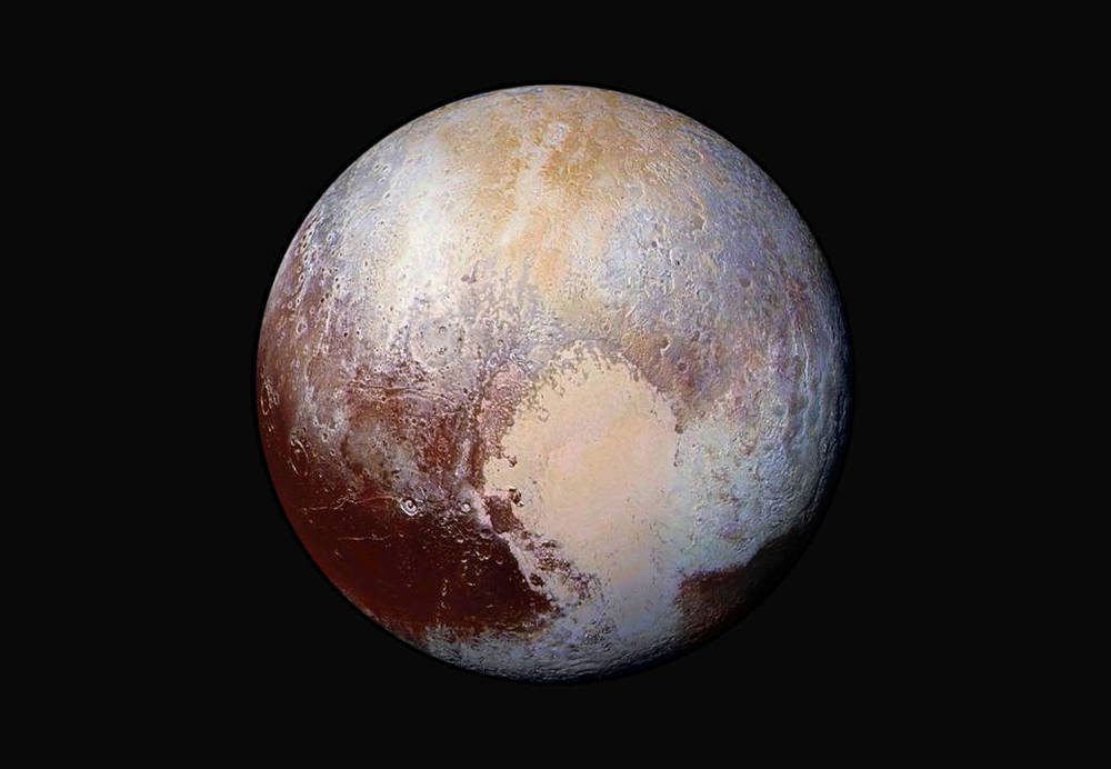 One of the latest false-color images of Pluto from the New Horizons probe. Photo: NASA