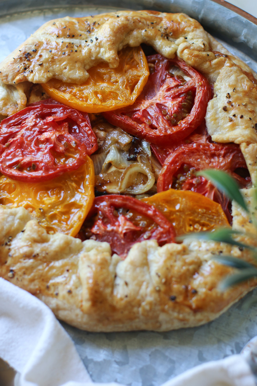 If you want more recipes for that pastry crust just take a peek at this easy Tomato Galette here. -
