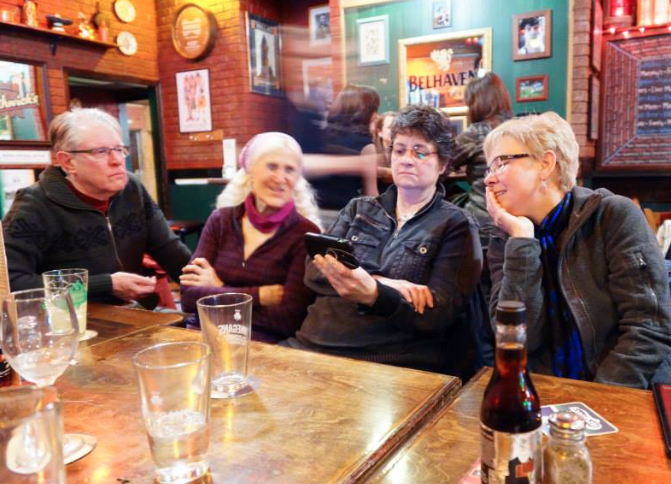 Birders can share photos or their favorite birding apps at a Birds and Beers.  Photo by Curt Rawn.