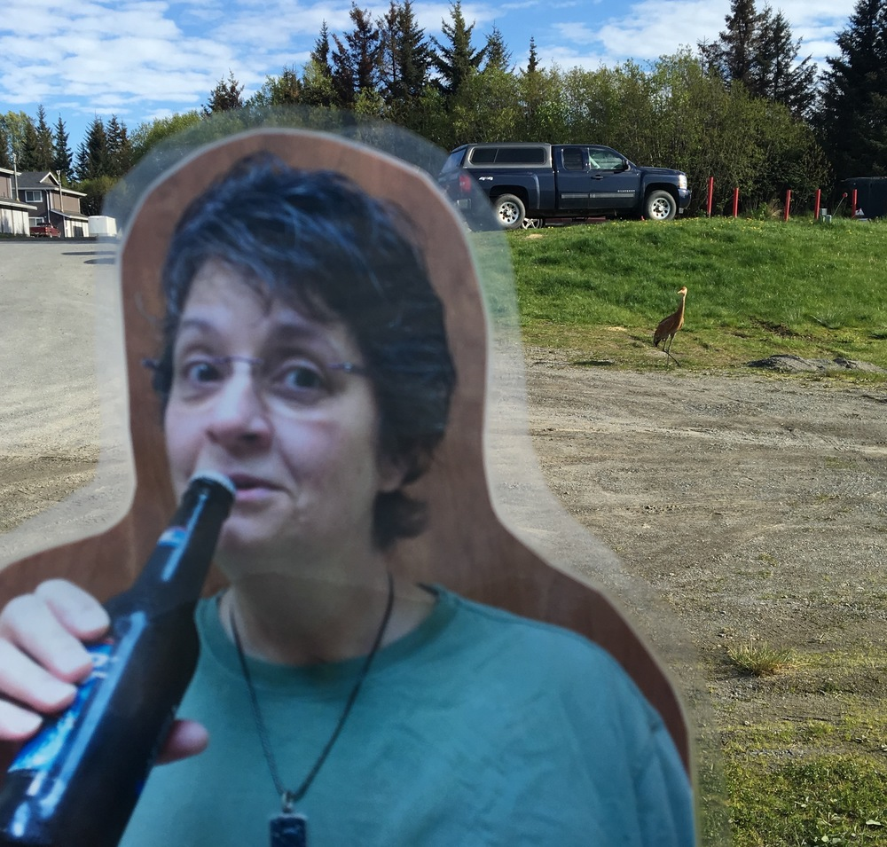 Flat Michelle kicking on back with an obliging sandhill crane in the background.