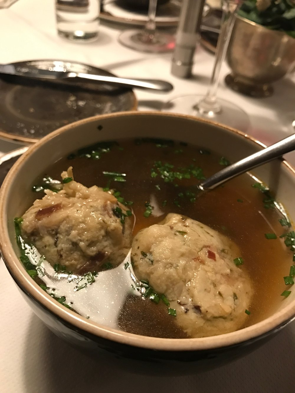 One of my favorite reasons to visit Austria: Speckknödelsuppe (bacon dumpling soup). Amazing plans were hatched over this soup and some stone pine schnapps.