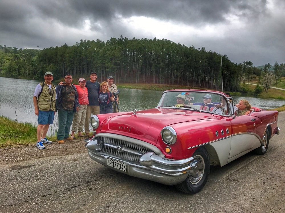 Those classic cars are everywhere. This one drove past as we were taking a group photo. Our overall guide Hiram Gonzales is second from the left.