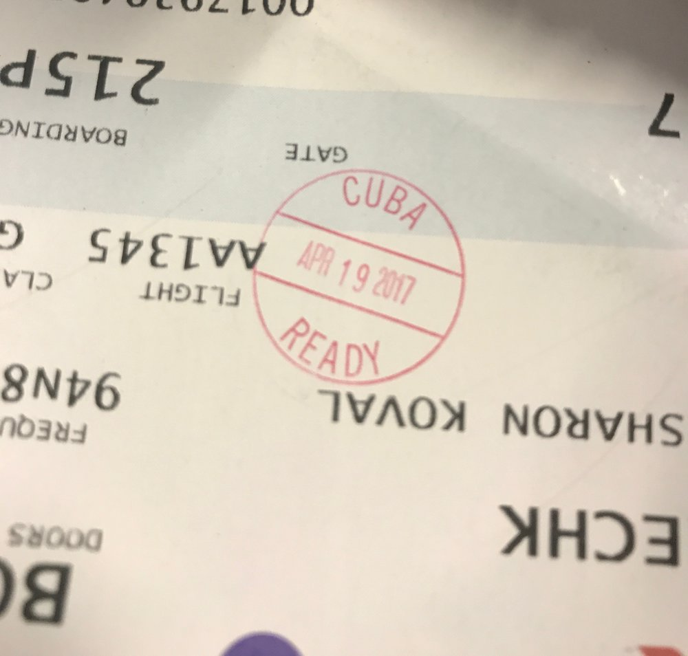 You get a special stamp on your boarding pass after you go through all the security hoops at the Miami Airport.