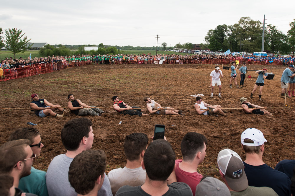 Spectators look on as the Pike fraternity competes against members of Alpha Tau Omega. Over 200 people showed up, despite the intermittent rain, for the annual event.