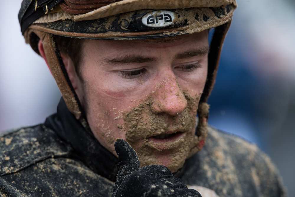 Jockeys, especially those towards the back of the pack, get painted with mud. They wear several layers of goggles, pulling each layer down throughout the race as they get covered in mud.