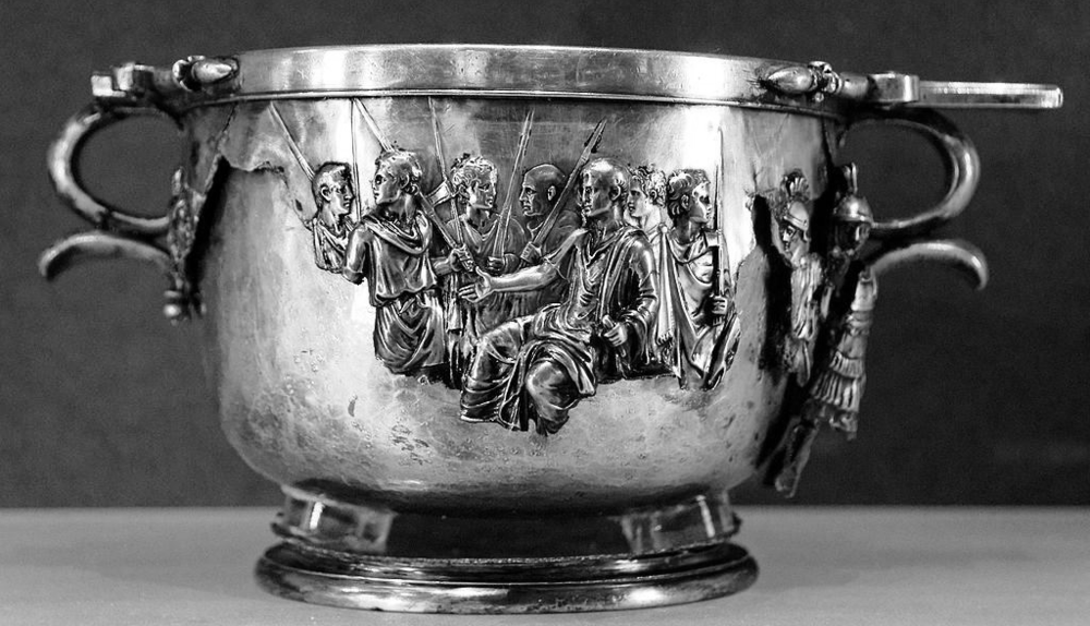 Seated Augustus receiving the obeisance of vanquished Barbarians and the personifications of subdued provinces, skyphos from the Boscoreale Treasure, late 1st century BC - nearly 1st century AD, silver with repoussè decoration, height: ca. 10 cm, diameter: ca. 12 cm (20 cm with the handles), Louvre Museum, Department of Greek, Etruscan and Roman antiquities, Sully, first floor, Salle Henri II, room 33, 1895 from Villa della Pisanella, Boscoreale, (C) Marie-Lan Nguyen