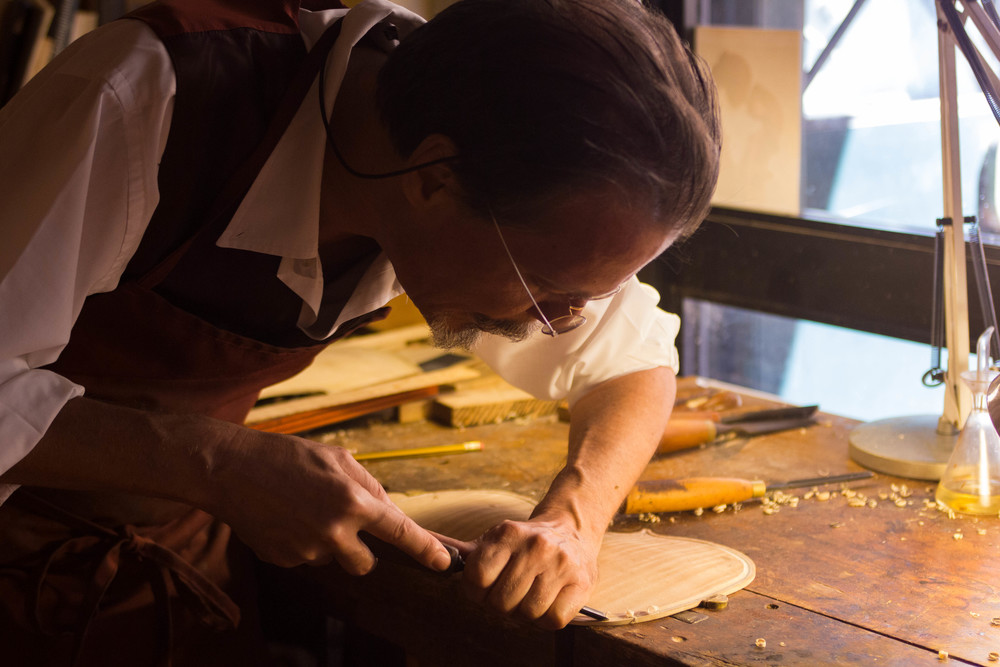 Our master luthier Michel in his violin workshop