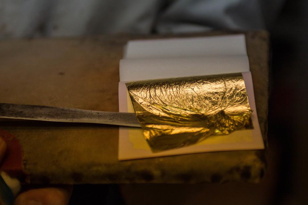 gold leaf, gilder's knife and cushion