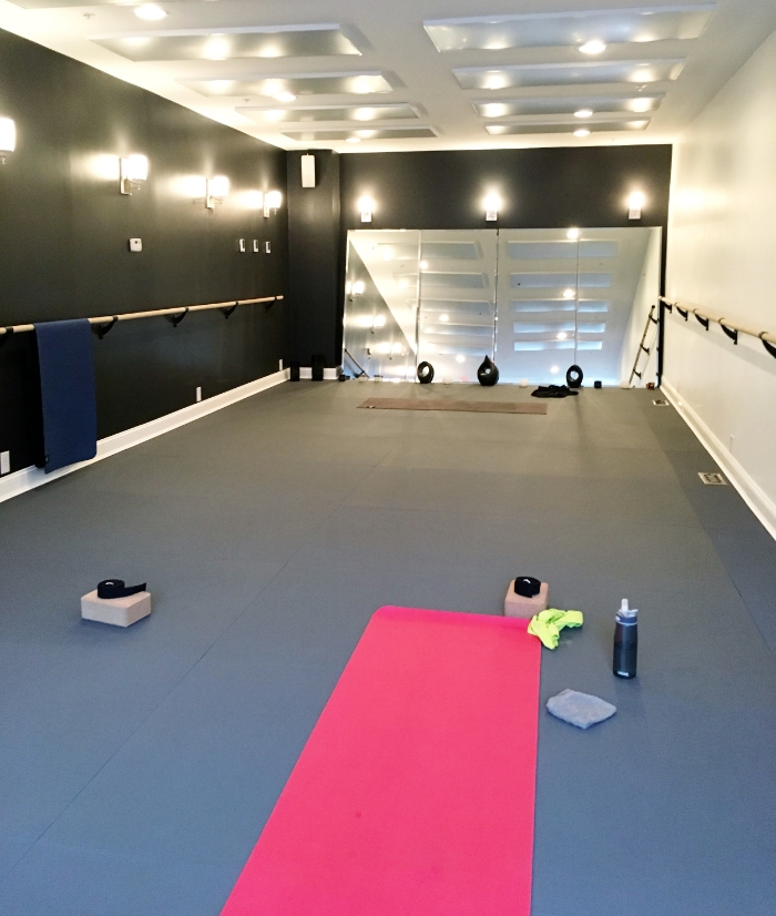 the yoga studio (with bright lights on for the picture), heated with infrared heating lamps to 100˚F