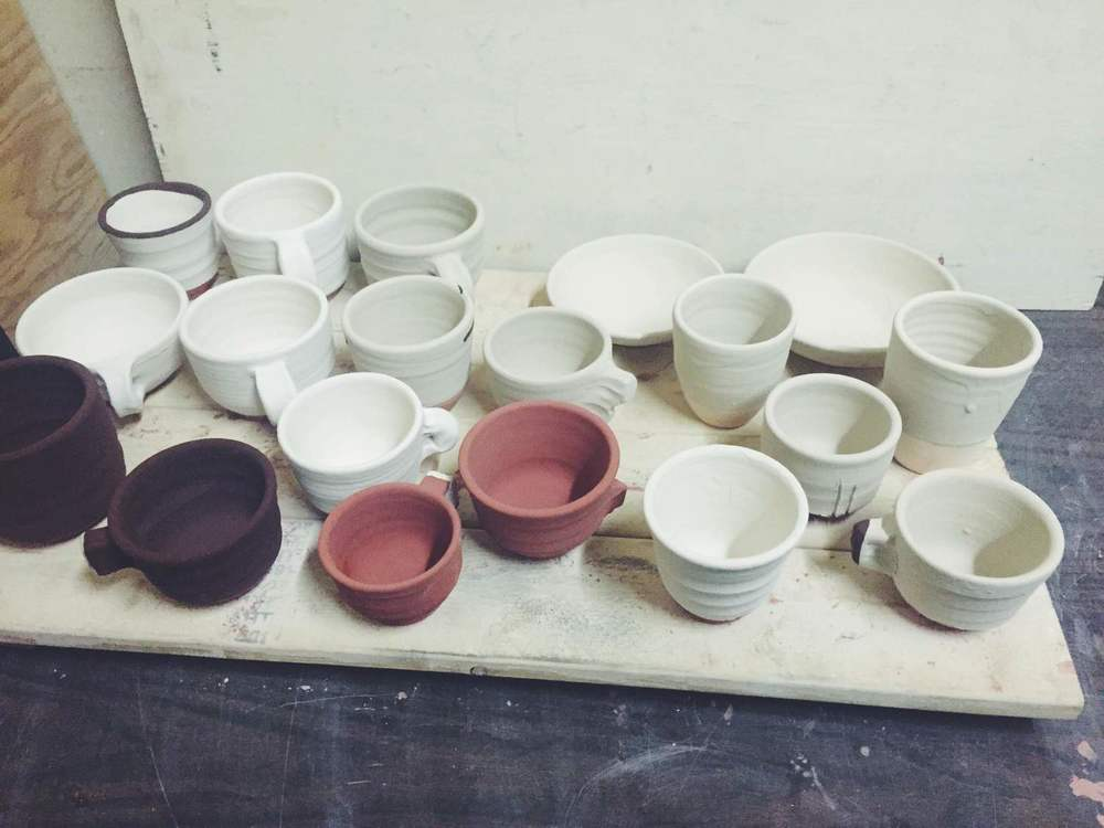 glazing bisque fired pottery before final firing