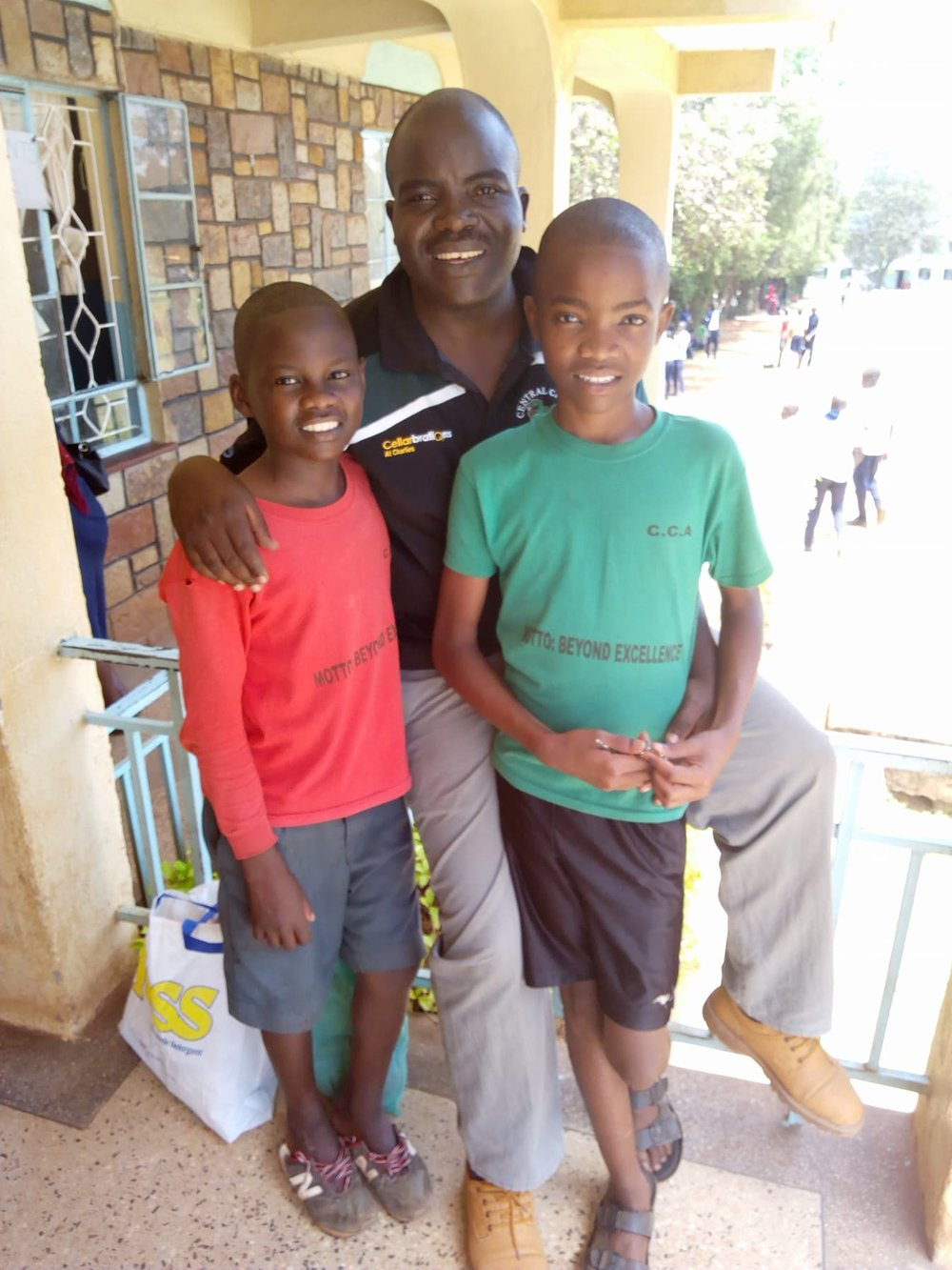 Wicklife (middle) visiting his son Samuel (right) and CCMI orphan Spencer (left) at Nyangori High School which is a 5 hour drive from Migori.
