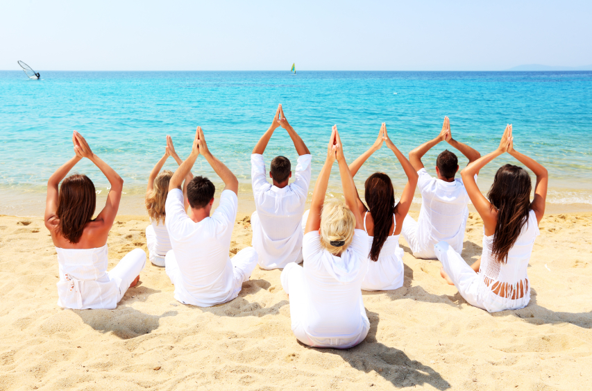 20-iStock_000015855535Small-group-of-people-exercise-yoga-on-the-beach.jpg