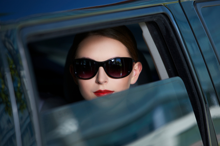 10-112115389-business-woman-in-limo.jpg
