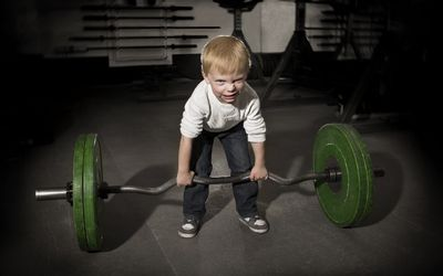 Teach them the fundamentals. Let them master the movements without weight. Then add weight.
