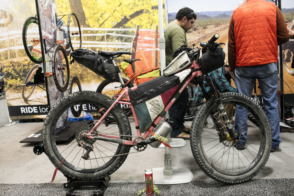 Nics' pink Meriwether 27.5+, with full Baja luggage.