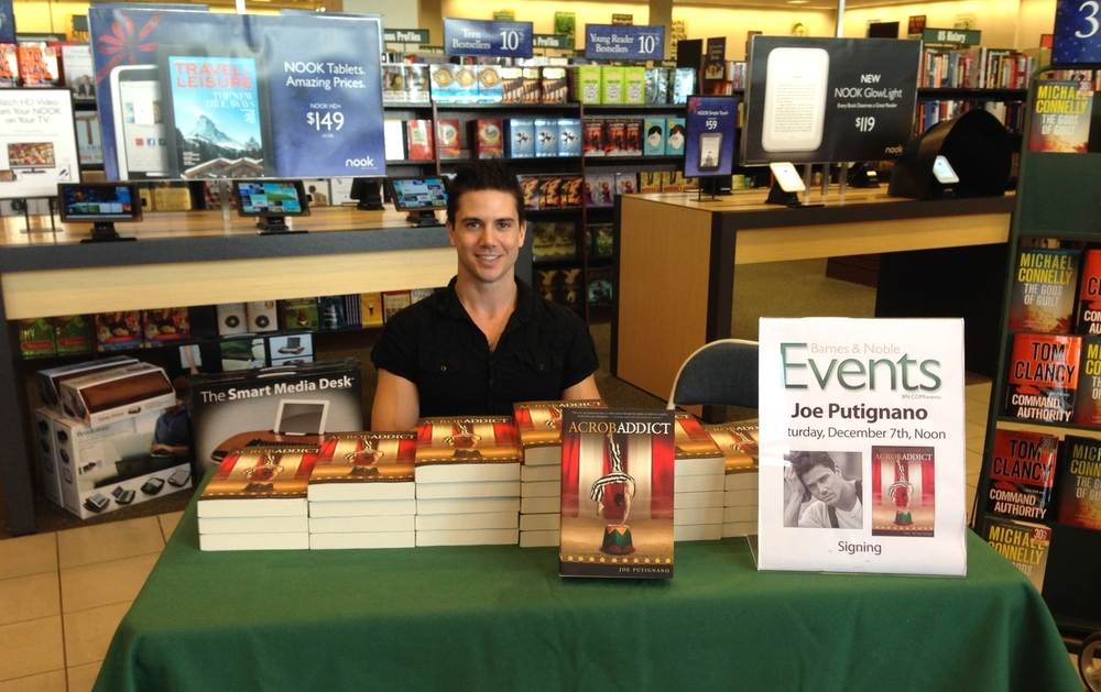 Joe Putignano signing copies of his book  Acrobaddict  at Barnes & Noble