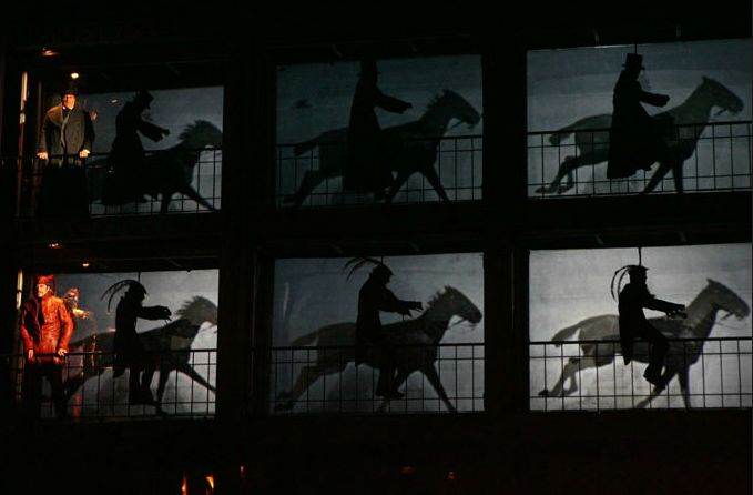 Joe Putignano and other acrobats hung from harnesses to simulate a horse riding chase.