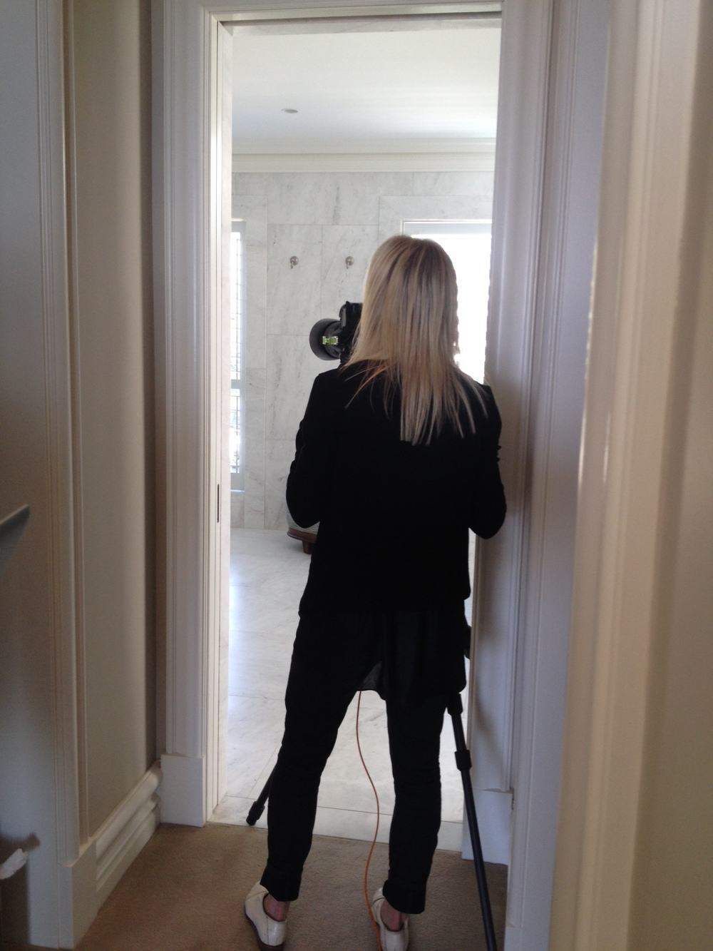 Sharyn Cairns shooting the master ensuite at Stanley Avenue