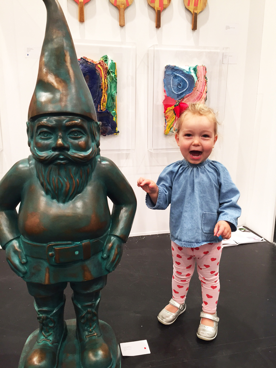 Alex's daughter Anouk sizing up the Gregor Kregar bronze gnome sculpture at Michael Reid Art.