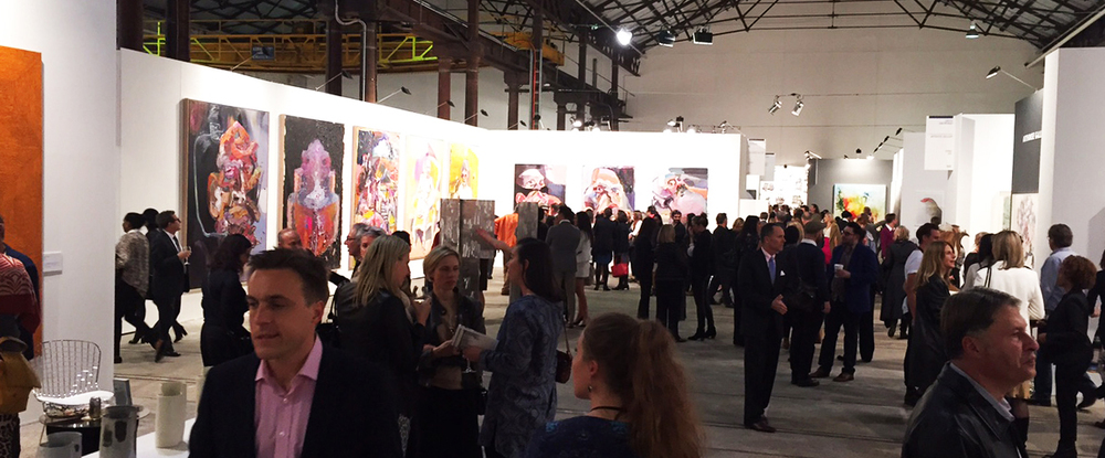 The halls of Carriageworks were abuzz with visitors enjoying the visual feast on display. Work in background by Ben Quilty represented by Jan Murphy Gallery, Brisbane.