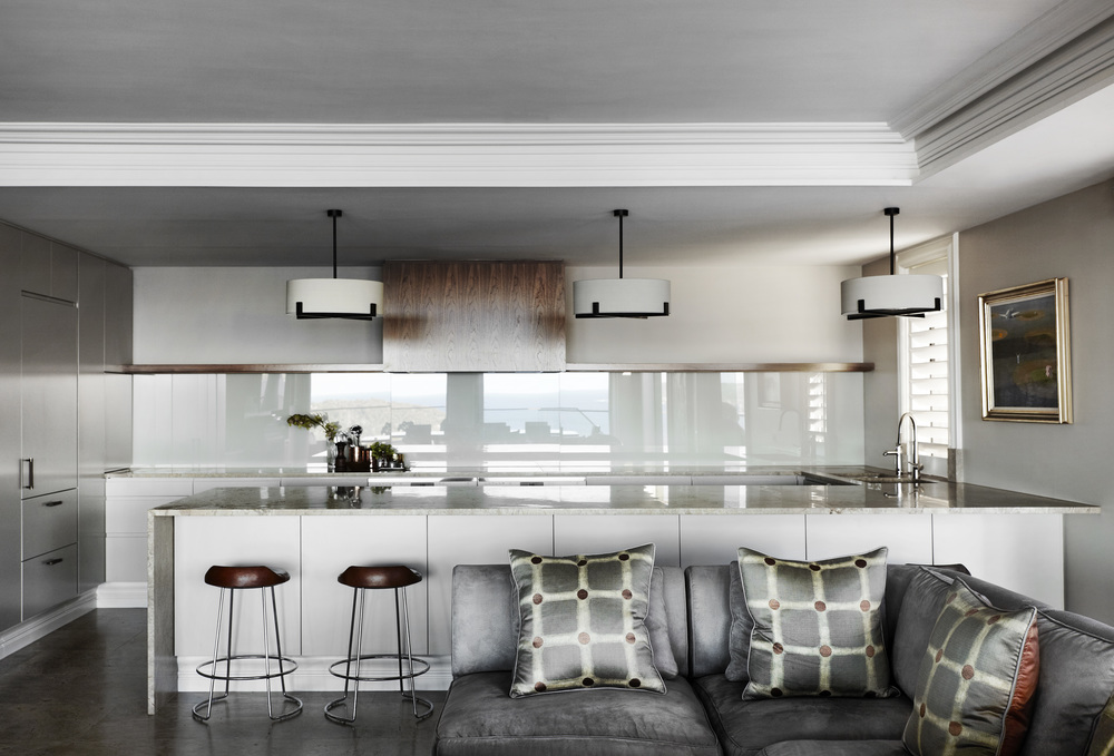 The kitchen in our  Stanley Avenue  project is perfect for entertaining with seating at the breakfast bar allowing for two-way conversation, plenty of bench space for prep and plating, stone flooring throughout the kitchen and living creates a cohesive and larger sense of space, and last but not least a good exhaust is a must!