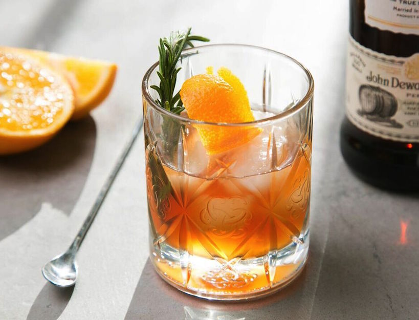 A warming winter cocktail such as the Rosemary Tuck (made of whiskey, rosemary and orange) is the perfect winter nightcap.