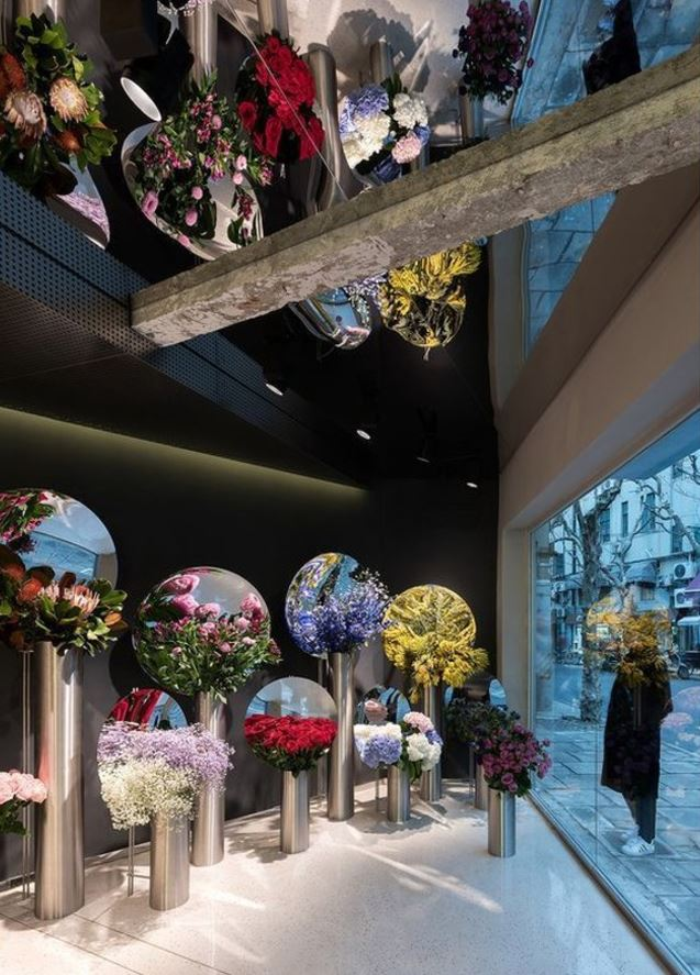 Brighten up these shorter, darker days with a beautiful blooming bouquet or two! Perfect for any season and any occasion. We love  Alberto Caiola's  contemporary interior design of Shanghai-based florists, July's Flower. The large mirrored dishes result in a cornucopia of blossoms reflected ad infinitum.