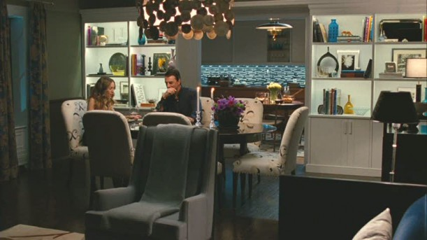 Carrie and Big's New York apartment in  Sex and the City 2  showcases mid-century modern with all the luxurious designer trimmings and furnishings one would expect from the leading lady who lives for fashion, and has confessed to buying  Vogue  instead of dinner!
