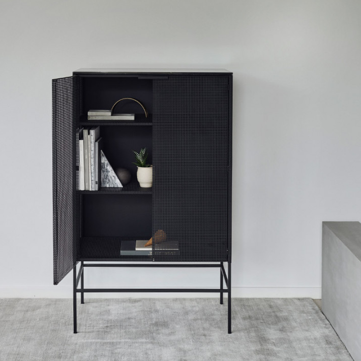 The 'Kristina Dam Studio Grid Cabinet' is made of black perforated steel and topped with a beautiful black marble plate. Available at  Design Stuff