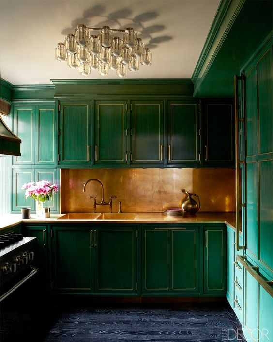 A g lossy green kitchen designed by  Kelly Wearstler  for Cameron Diaz's Manhattan apartment. The brass splashback was left un-lacquered to create a beautiful patina with age.