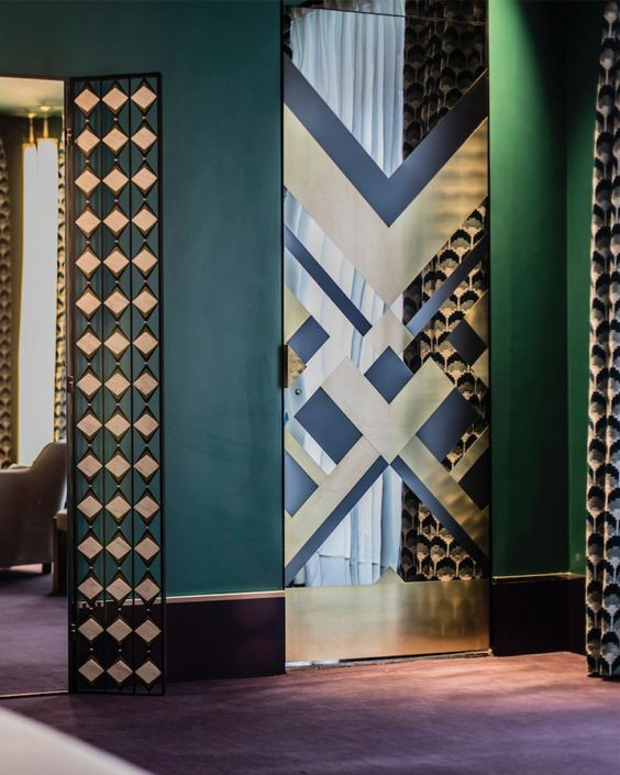 Hotel Saint-Marc in Paris by  Dimore Studio . Brass inlay to the mirrored pivot doors is pure perfection when paired with deep forest green walls