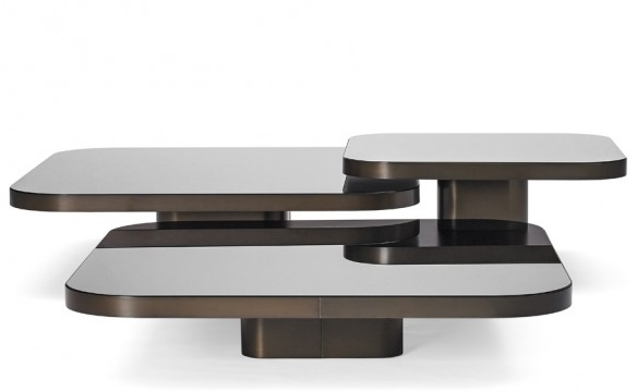These retro-inspired  Classicon Bow Coffee by Guilherne Torres  provide the perfect balance between casual and elegant with their beautiful deep burnished brass and glass tops that reflect the surrounding space. The three tables come together to create a dynamic and moody sculptural centrepiece for any lounge room.