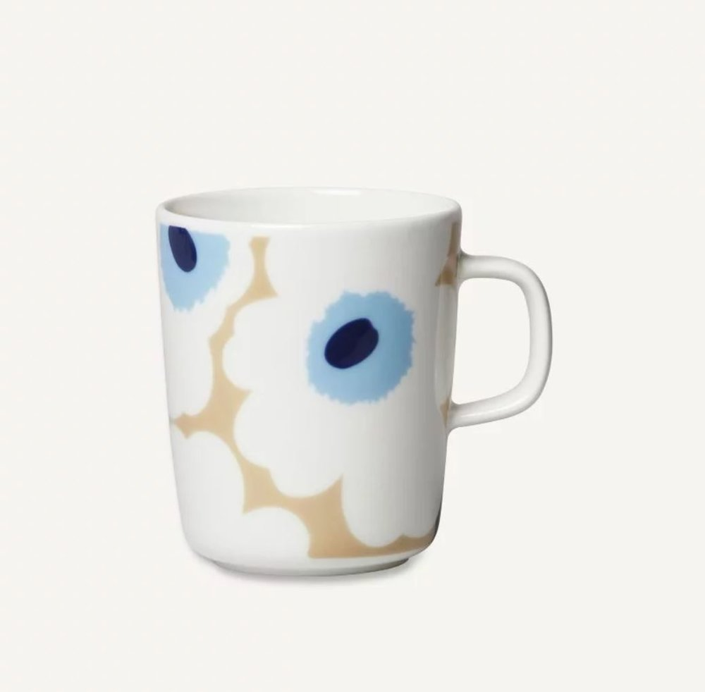 The  Marimekko 2018 collection  is here and it has not disappointed. The beautiful muted tones of beige and soft blue pair perfectly with their signature Unikko floral pattern designed by Maija Isola reminding us that Spring will come again soon enou  gh. Meanwhile this white stoneware mug is the ideal Autumn accessory for warming cups of tea on those cool mornings.