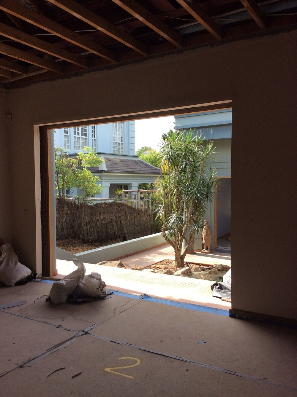 The internal courtyard is a natural suntrap, so we will be installing frameless glass windows to all sides to harness and embrace it's light and warmth. The landscaping is undergoing a re-fresh by Outdoor Establishments to make the space even more special.