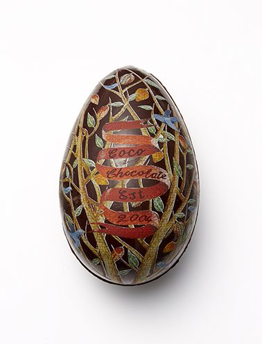 A  Coco Chocolate  organic chocolate egg painted with cacao butter artwork simply melts away as the chocolate is eaten.