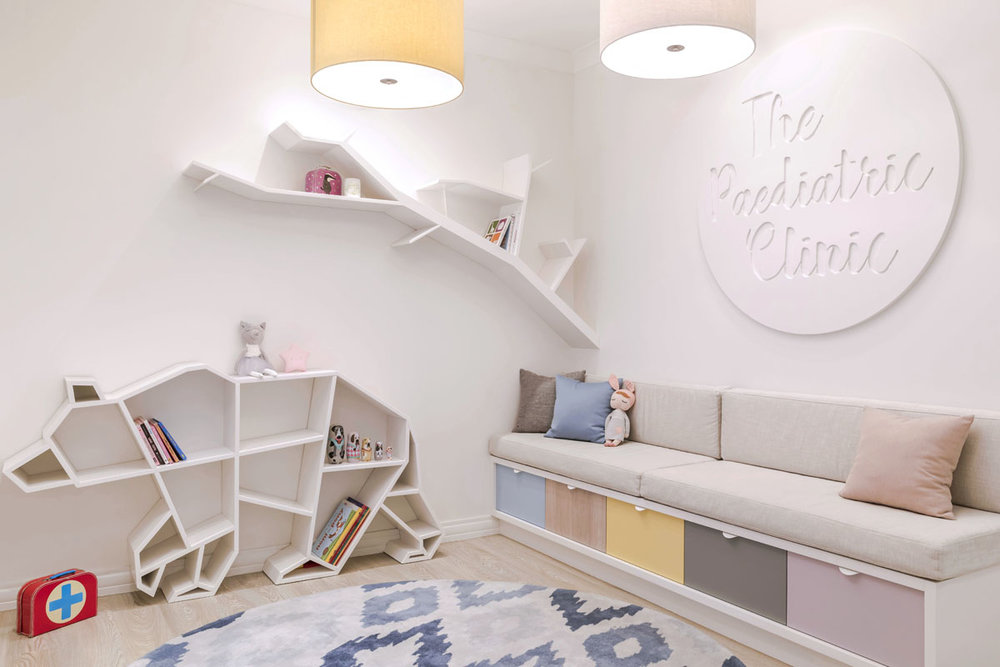 We created a custom 'bear and branch' library to house plenty of books and toys to keep the little ones occupied.