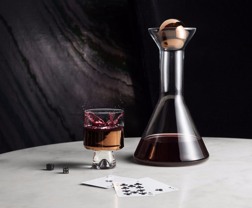 Design excellence on your table top, this  Tom Dixon  decanter (and matching low ball glasses) would look as striking filled with your finest wine as it would adorning your credenza. And in hand painted copper, of course…!