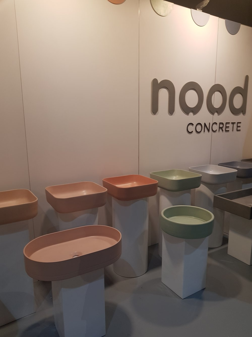 A rainbow of basins a Nood Concrete's stand!