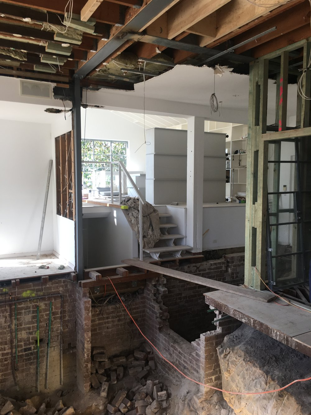 The stairs leading to the mezzanine level is currently accessed via a plank!