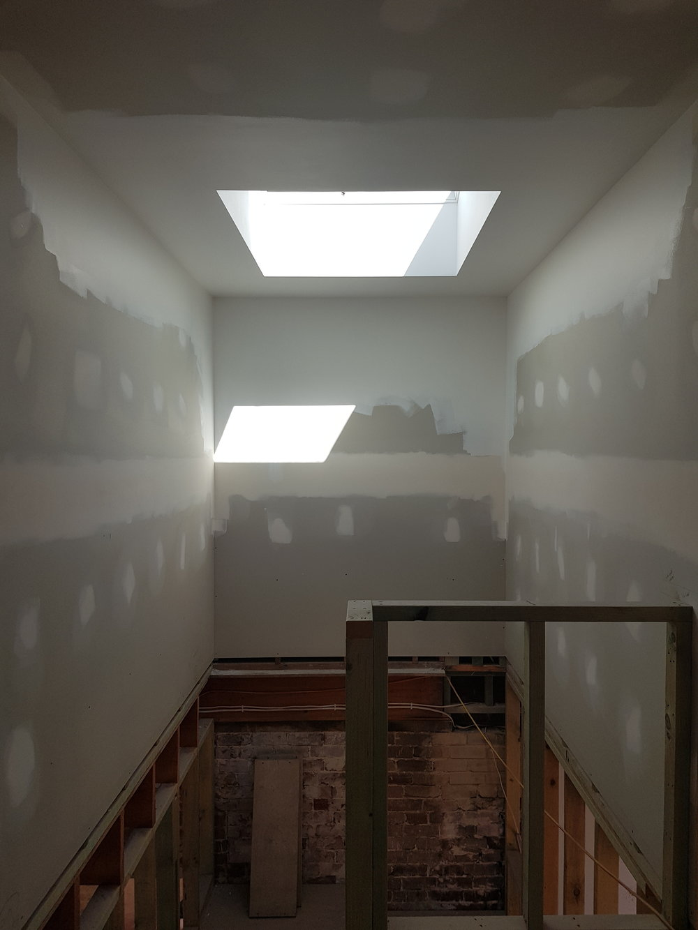 Admiring the light filtering through the new skylight.
