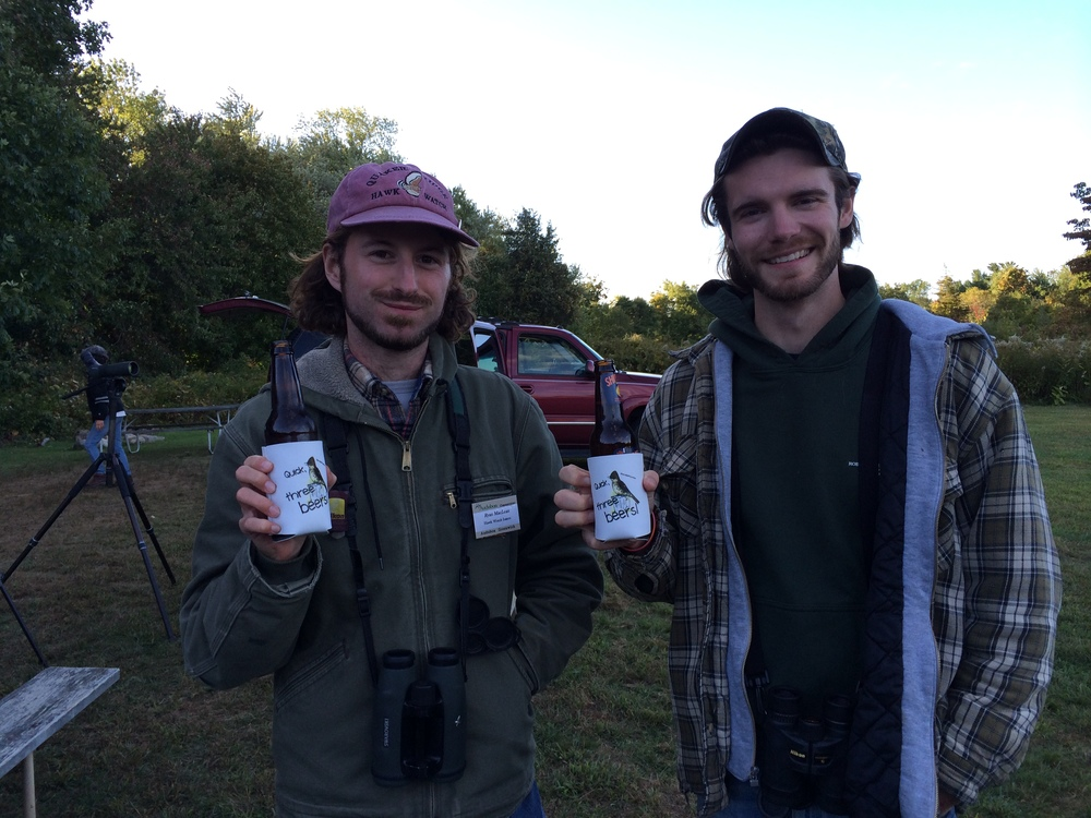 "Hawk watchers Ryan and Shawn celebrate another successful day with their new ""Quick, Three Beers!"" beer cozies!"