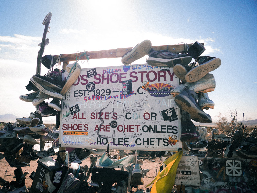 Ho's shoe story. A whole lot of shoes. Along the highway heading from Lake Havasu to Joshua Tree.