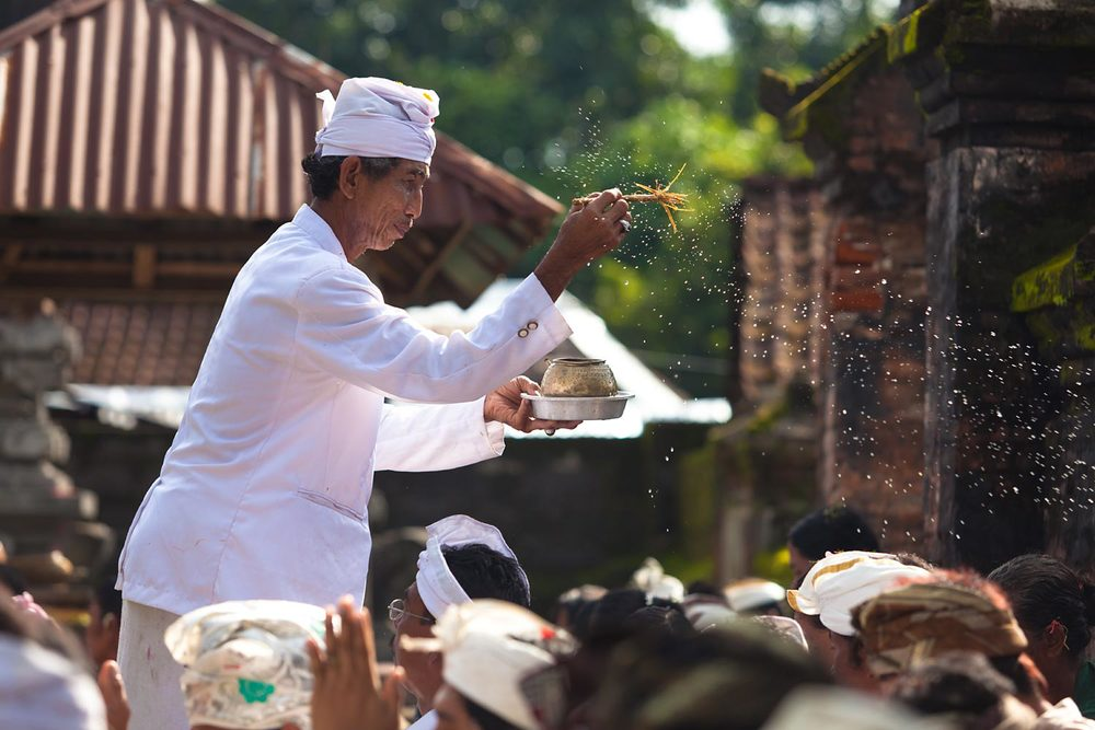 Purification ritual at temple ceremony | Bali