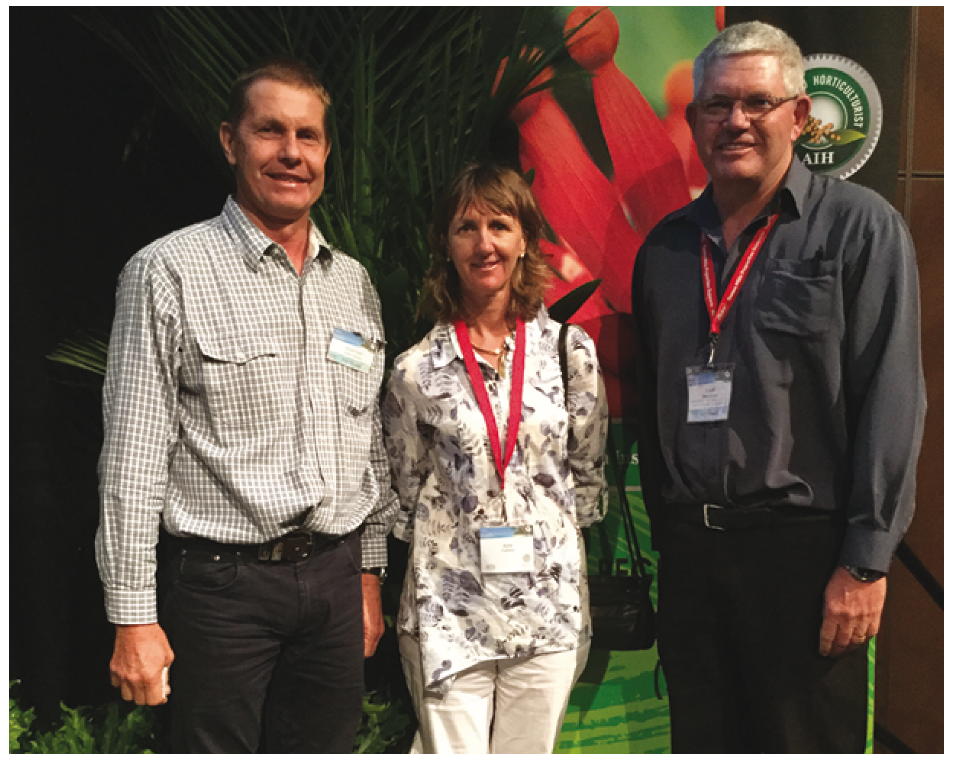 Conference panellists and Mareeba fruit growers Gerard Kath and Kylie Collins with DAF Senior Horticulturist, Dr Geoff Dickinson.