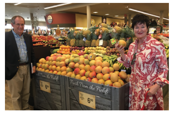Michael Daysh (NTDPIR Market Development Officer) and Treena Welch (AMIA Marketing Manager) pictured with one of the Australian mango displays in the U.S.
